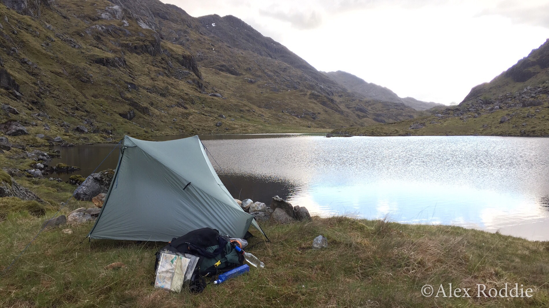 Alex's first wild camp at Lochan a'Mhaim, a few hours before the storm rolled in